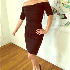 Badgley Mischka black cocktail dress Beautiful off the shoulder little black dress. Size 2 fits like a 0. Badgley Mischka Collection. 71% Rayon 29% polyester. Great condition. Only worn once. The bottom seem is a tid lose. Badgley Mischka Dresses Mini