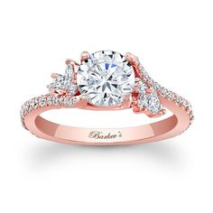 Simply elegant describes this rose gold diamond engagement ring.  Featuring a prong set round diamond center graced on each side with a flare of marquise diamonds and round diamonds cascading down the dainty shank  for a touch of sheer elegance.<br />  <br />  Also available in white, yellow gold, 18k and Platinum.<br />