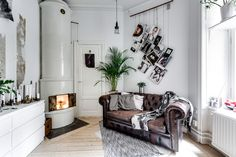 A cool tiny studio apartment with Chesterfield sofa and loft bed