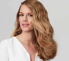 Glam up your waves with Virtue. Double cleanse your hair with Recovery Shampoo (cool water) and finish with Smooth Conditioner from your scalp to your ends. Towel dry your hair, using a fine tooth comb to stretch any curls, then apply The Uplifted Volumizing Whip from the scalp to the ends. Dry your hair with a diffuser and your fingers. Keep as much wave in your hair as possible. Finish with a large barrel iron. Use the Finale Shaping Spray over the top of your hair to control and add…