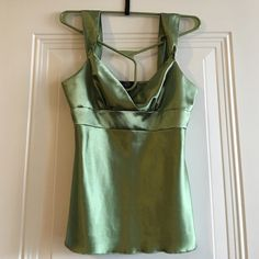 """The Grass Is Always Greener Perfect for a picnic in the park. Sateen/silky soft green top with a V neck and wide shoulder straps. Looks perfect with jeans and heels or a cute skirt. My Michelle, Size M, 25"""" from top of shoulder strap to hem, 15"""" waist, no stretch so would be comfortable for size 0-6/8. 97% Polyester, 3% Spandex. Note: Very small stain marks shown in last pic on back of top. Slight wear visible but only if you are inspecting closely. My Michelle Tops Blouses"""