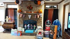 DIY Halloween Themed Baby Shower Decor Ideas. Bigger view of some of my gifts. We used orange & black curtains to set the scene. And other cute, little tidbits.