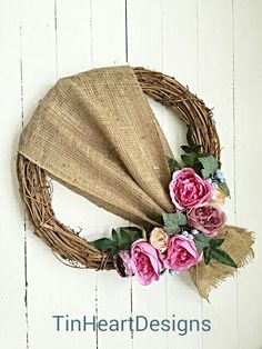 This 18 grapevine wreath has been decorated using high quality artificial flowers and berries and has been draped with burlap. It would be a lovely addition to any home inside or out!    If hanging outdoors, it is suggested to place in a well covered area away from rain and direct sunlight. Your wreath will be shipped in a sturdy box that is also great for storing! Please allow approx. 3-5 business days from the time of payment for item to be shipped.    Thank you