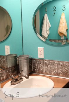 DIY faux tin til ceiling tile back splash...love this!!! Easy bathroom mirror update even *I* could do!