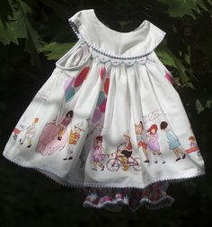 Looks like the Kewpie pattern from A S & E; I love everything made with this Sarah Jane fabric