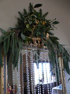 Garland of eucalypt and other foliage for mirror top.. Crystal garlands