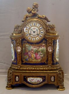 Antique French porcelain and ormolu mantle clock with painting after Boucher. at Gavin Douglas Fine Antiques Ltd. in London, specialists in antique clocks and decorative gilt bronze Mantel Clocks, Old Clocks, Antique Clocks, Rare Antique, Mantle, French Clock, Clock Shop, Retro Clock, Modern Clock