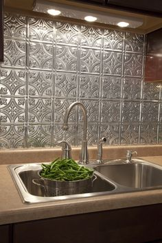 Love this pattern for a tin backsplash.