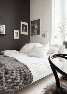black accent walls bedroom with gray blanket