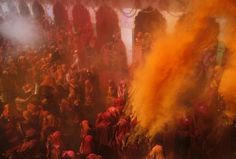 "Men and women take part in ""Huranga"" as others throw coloured powder at Dauji temple near the northern Indian city of Mathura March 9, 2012. Huranga is a game played between men and women a day after Holi, the festival of colours, during which men drench women with liquid colours and women tear off the clothes of the men"