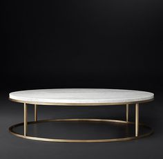 Sitting room-RH Modern's Nicholas Marble Round Coffee Table:Pairing marble's luminous warmth with metal's cool luster, this table designed by the Van Thiels is a study in complementary contrasts. Inspired by a 1960s French original, it is a striking surface for display.