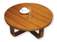 This sleek natural wood coffee table appears in a traditional circular shape, with unique curved wood base. The singular look of the wood grain and contemporary styling helps it mesh with any space.
