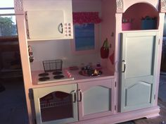 Children's kitchen made from old entertainment center