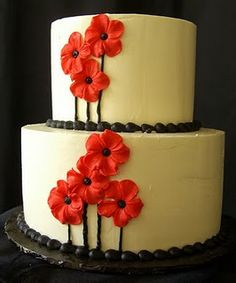 Pretty red poppies adorn this wedding cake.