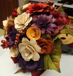 Paper flowers ,Roses and various flowers .In any color of your wedding theme... 7 to 8 inches around   A free matching boot in your choice of colors...and handle wrapping in your choice of colors. You are paying for brides bouquet only...here  This is perfect for the budget Bride..or 2nd or 3rd or 4th time bride..Quick wedding in Las Vegas..or in front of a judge in the courthouse.. Use it for your toss bouquet....your bachelorette party, Rehearsal ..  This also looks so pretty in a vase…