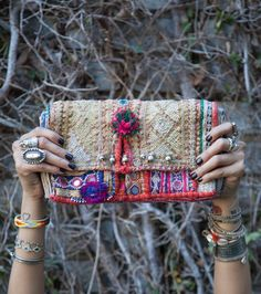 One of my most cherished accessories is my CL Bazaar Embroidered Clutch, hand selected by Chan herself on her most recent trip to India. It adds the perfect punch of color against my Off the Should...