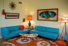Charming Home Interior Design With Retro Living Room Ideas Along With Double Blue Leather Sofa On Penny Patterned Orange Area Rug In Dramatic Dull Lighting