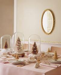 Mini Christmas trees housed under a dome - very Martha Stewart.