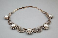 An antique diamond and natural pearl swag necklace, : Lot 225