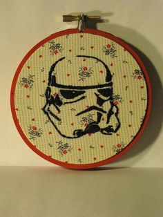 Geek embroidery on old-timey looking backgrounds. Katie needs this with a rose background.