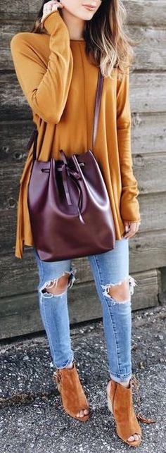 Mustard top and tan shoes with blue jeans. Love the burgundy handbag.