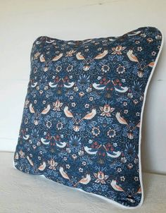 William Morris indigo 'Strawberry Thief' cushion with white piping edge. Check out this item in my Etsy shop https://www.etsy.com/uk/listing/517538497/william-morris-strawberry-thief-cushion