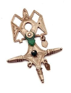 Africa | A silver and glass cross pendant ~ 'croix de Tahoua' ~ from the Tuareg people of Niger | 20th century