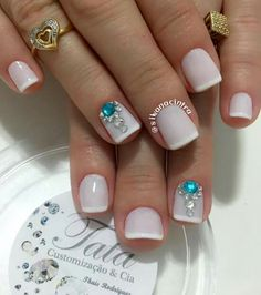 White semi transparent coat, some gorgeous gems, and a bit of a french tip