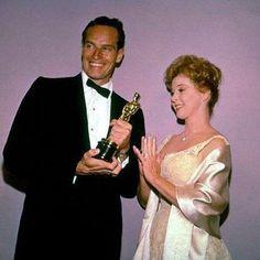 Susan Hayward presents the Oscar to Charlton Heston for Ben-Hur. - 1959