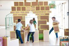 """Modular blocks made from cardboard & tape. Some are upholstered for a """"living room"""" effect"""