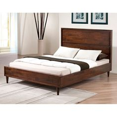 This platform bed frame is crafted from rubberwood to offerstrength and durability. The tobacco-brown finish adds modern styleto any bedroom and complements most bedroom decor. Twelve hardwoodbed slat