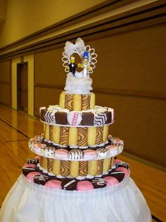"nothing says ""elegant but fun couple"" quite like this twinkie wedding cake. great way to show off your personality and still be thrifty!!!"