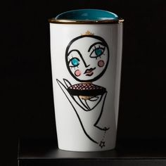 """Blusher Double Wall Traveler, 12 fl oz Hello, gorgeous: a reflection of a blushing face forms the center dot in this fun Dot Collection design.The mug shines with metallic details, from the gold rim to the """"clasps"""" of the compact mirror design. The ceramic mug's double wall construction helps keep coffee hot while hands stay cool, and its blue ceramic press-in lid with silicone seal minimizes spills. Holds 12 fl oz. Handwash only. Do not microwave. No trade or pp Accessories"""