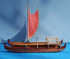 Simplified Hawaiian voyaging canoe with red sail resting on mahogany wooden base. Length of display: 12 inches. Also available with showcase. More information on www.etsy.com/shop/FrancisPimmel
