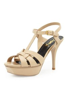 """Tribute Leather Mid-Heel Sandal by Saint Laurent at Neiman Marcus.  $925  Tribute Leather Mid-Heel Sandal      Saint Laurent matte calfskin sandal.     4"""" heel with 1 1/4"""" platform; 2 3/4"""" equiv.     Wide straps loop together over vamp.     T-strap connects to ankle strap.     Leather lining and sole.     Made in Italy."""
