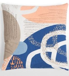 The Cove Printed Cushion in Dark Blue and Orange Mix. Vibrant colours and patterns screen printed by hand. £20 | MADE.COM