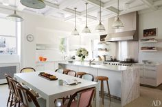 30 White #Kitchen Design Ideas  - #White kitchens will never go out of style. In a modern #home, a cool hue makes a clean statement with lacquered white cabinets and stainless-steel fixtures. @agniestates