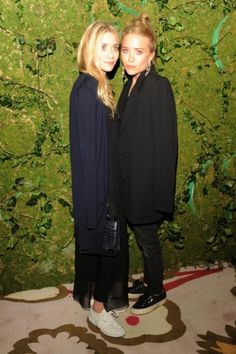The Olsen twins style file: Ashley and Mary-Kate Olsen attend Superga's Crosby Street store opening party, wearing The Row.