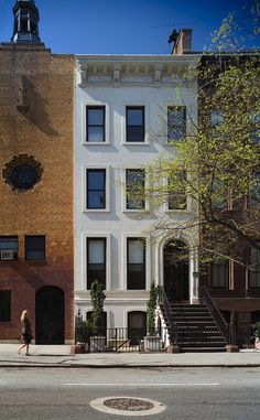 Historic facade of the NYC Townhouse is restored with care Exquisite NYC Townhouse Renovation Blends Historic Appeal With Modern Aesthetics