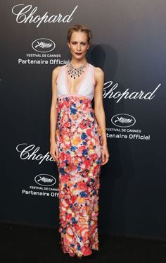 Poppy Delevingne in Chanel Couture with Chopard jewelry at Chopard's Gold Party at Cannes.