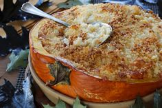 So cool for a Fall and/or Halloween party... Mac and cheese baked into a pumpkin half.