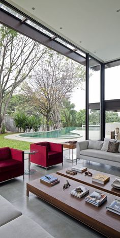 Indoor / outdoor living space - AM House by Drucker Arquitetura