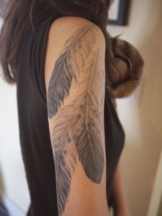 Large feather tattoo for women