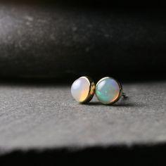 Bezel set 5mm opal stud earrings set in solid 18k yellow gold