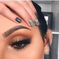 Whether you like subtle sparkle or want to bring the drama with tons of shine, consider this your guide to the season's metallic eye trend