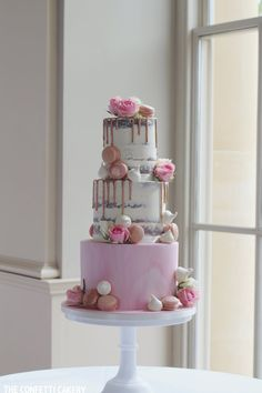 Modern semi-naked and marble wedding cake with macarons and meringues. At Stubton Hall, by The Confetti Cakery.