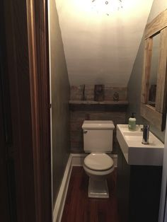 small under the stairs powder room we recycled barn wood on the walls mirror