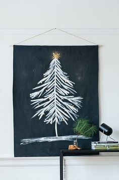 Space-Saving Alternatives to a Real Christmas Tree | there are so many options out there that won't leave you feeling cramped in your small space. And need I mention, they won't leave you with pine needles and sap all over your carpet. If you can forgo the scent of a real tree for something a little more apartment-friendly, these are the projects for you.