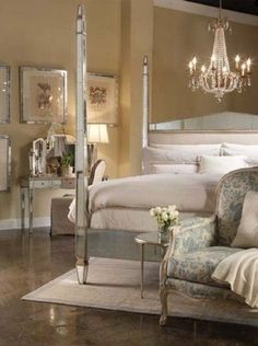 The use of a mirrored dressing table, a mirrored bed and a beautiful chandelier, give this room an elegant look...