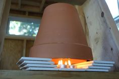 A DIY Tiny House Heater that really works. Candles last for about 4 hrs.